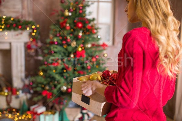 Woman holding box with baubles  Stock photo © LightFieldStudios