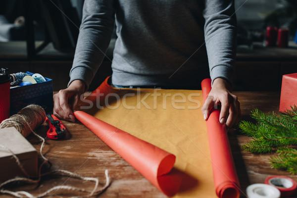 Nő karácsony ajándék lövés ki csomagolópapír Stock fotó © LightFieldStudios