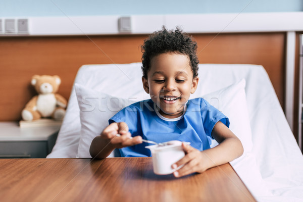 african american boy eating yogurt  Stock photo © LightFieldStudios