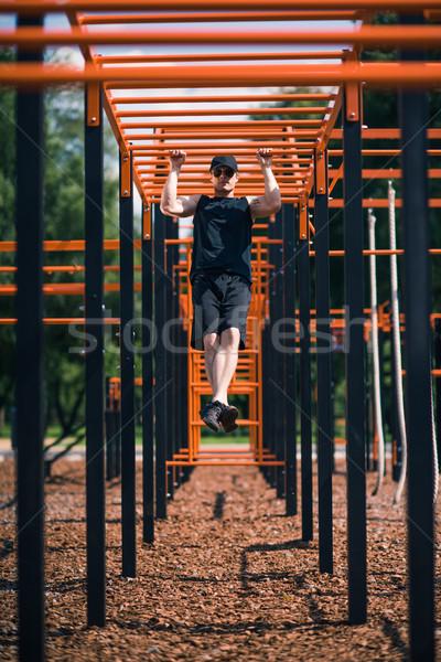 man exercising on sports ground Stock photo © LightFieldStudios