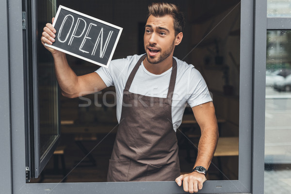 Stock photo: waiter holding chalkboard with open word