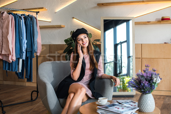girl talking on smartphone in boutique  Stock photo © LightFieldStudios
