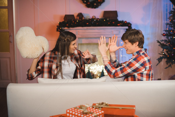 Paar kussengevecht zijaanzicht christmas ingericht kamer Stockfoto © LightFieldStudios