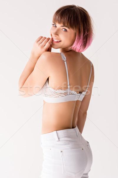 Uśmiechnięta kobieta koronki młodych biały dżinsy stwarzające Zdjęcia stock © LightFieldStudios