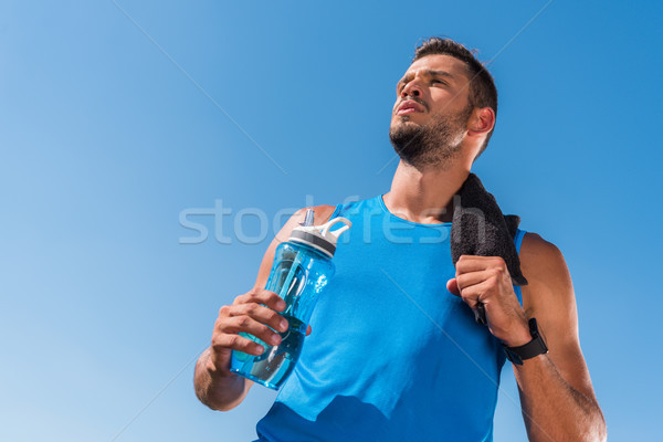 sportsman with towel and sport bottle Stock photo © LightFieldStudios