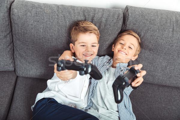Fiúk játszik boldog kicsi fiútestvérek tart Stock fotó © LightFieldStudios