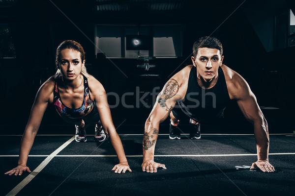 Fit couple doing push ups Stock photo © LightFieldStudios