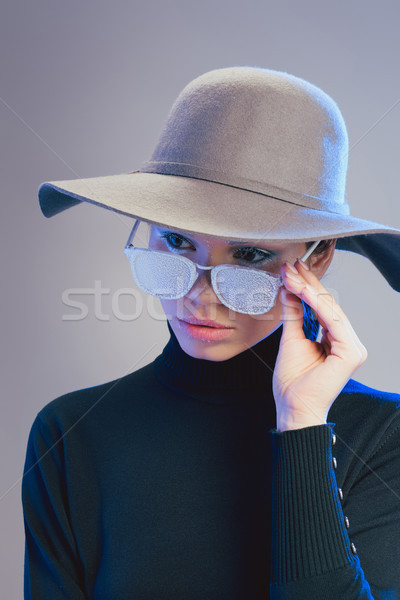 woman in trendy hat and sunglasses Stock photo © LightFieldStudios