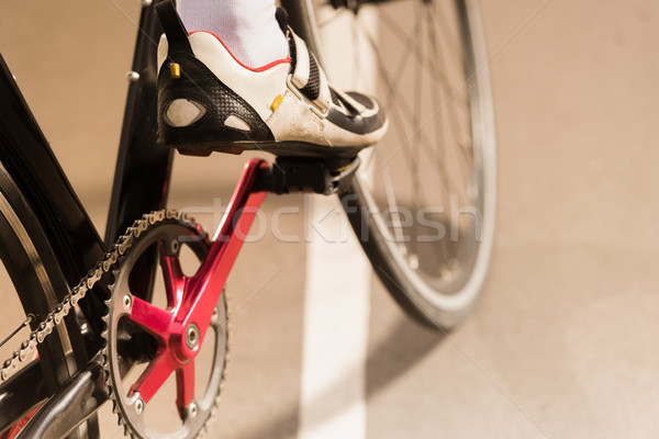 cyclist riding bicycle on cycle race track Stock photo © LightFieldStudios