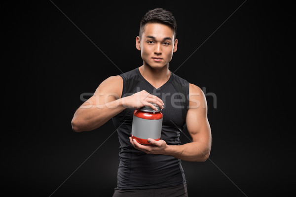 muscular man with sport nutrition Stock photo © LightFieldStudios
