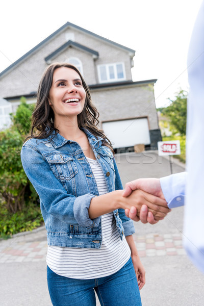 woman shaking hands with realtor Stock photo © LightFieldStudios