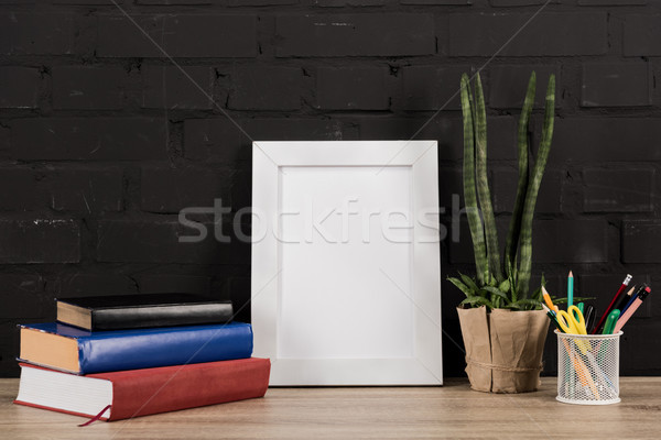 photo frame and book on tabletop Stock photo © LightFieldStudios