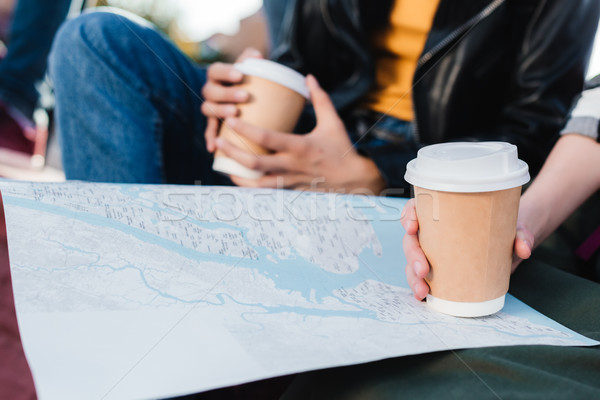 women with map and coffee to go Stock photo © LightFieldStudios