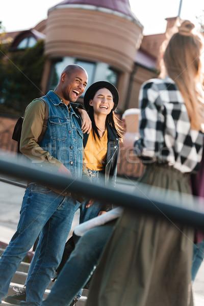 Feliz multicultural amigos vista calle mujeres Foto stock © LightFieldStudios