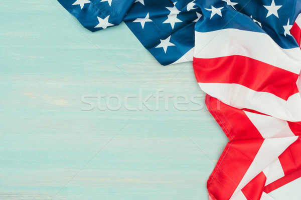 close up view of folded american flag on blue wooden tabletop, presidents day concept Stock photo © LightFieldStudios