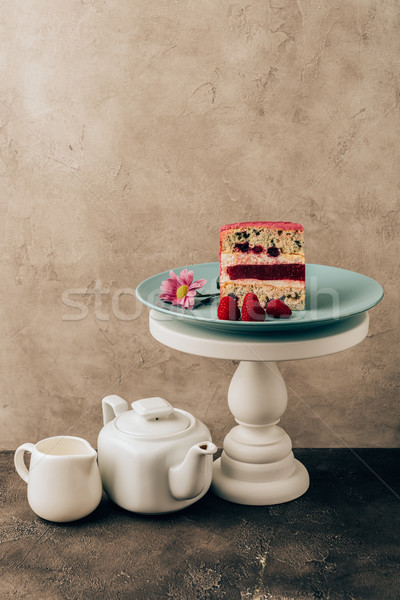sweet tasty cake with raspberries and flower and kettle with porcelain jug Stock photo © LightFieldStudios