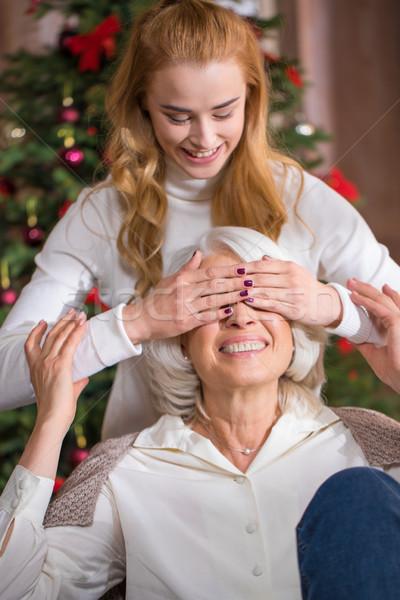 Happy teen girl with her grandmother Stock photo © LightFieldStudios