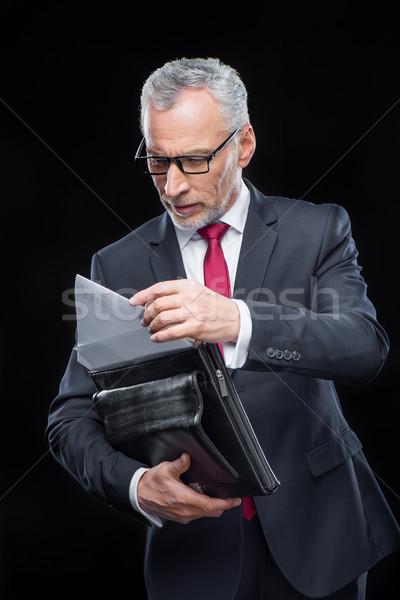 бизнесмен портфель зрелый глядя документы Сток-фото © LightFieldStudios