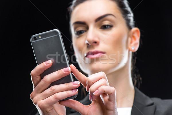Businesswoman using smartphone Stock photo © LightFieldStudios