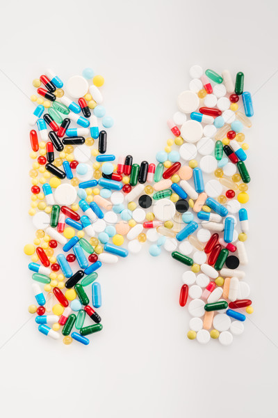 Top view of letter H made from medical pills and capsules, medicine and healthcare concept Stock photo © LightFieldStudios