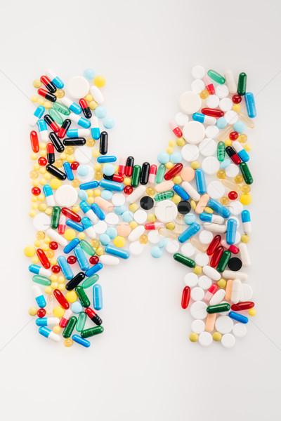 Felső kilátás h betű orvosi tabletták kapszulák Stock fotó © LightFieldStudios