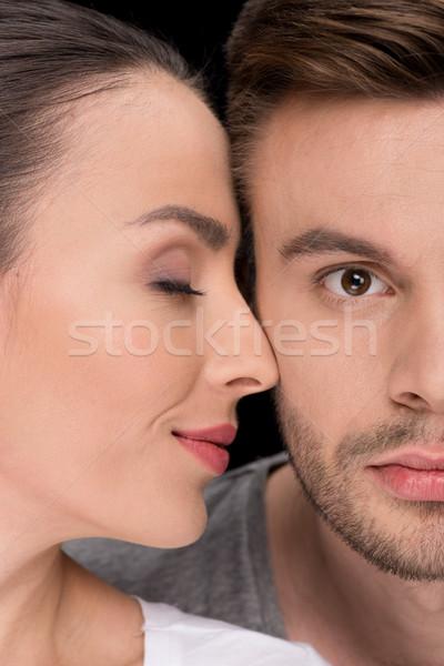 headshot of smiling woman bonding to man looking to camera on black Stock photo © LightFieldStudios