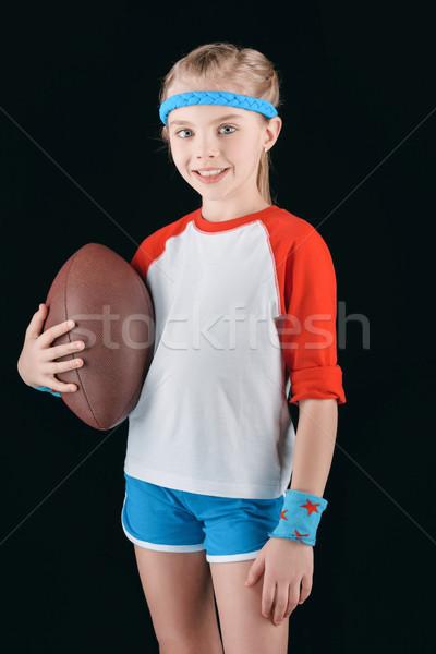 Portret mały dziewczyna rugby ball odizolowany czarny Zdjęcia stock © LightFieldStudios