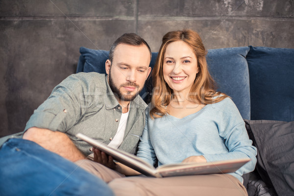 Couple reading in bed Stock photo © LightFieldStudios