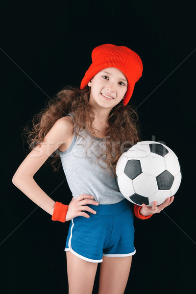 Stock photo: portrait of sportive girl with soccer ball isolated on black, active kids concept