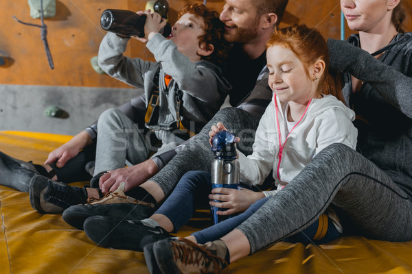 Family with children on mat at gym Stock photo © LightFieldStudios