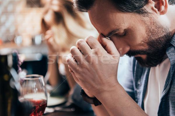 Férfi imádkozik vacsora közelkép kilátás szakállas Stock fotó © LightFieldStudios