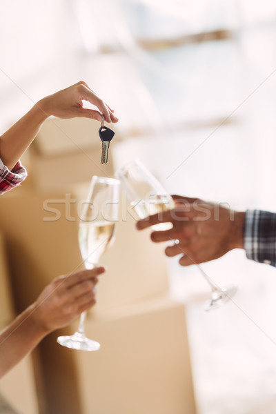 Stock photo: couple drinking champagne in new house