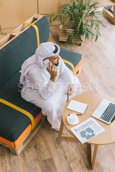 muslim businessman talking by phone Stock photo © LightFieldStudios