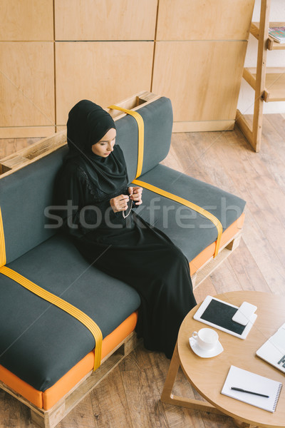 muslim woman with prayer beads Stock photo © LightFieldStudios