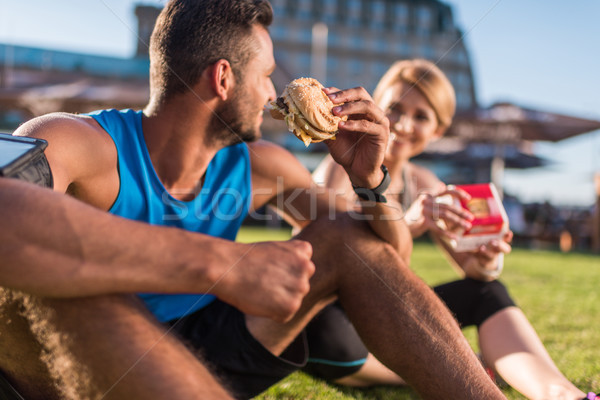 sports couple eating junk food Stock photo © LightFieldStudios