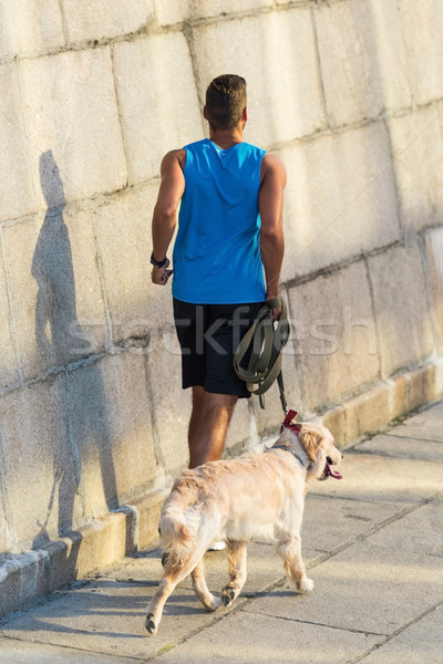 sportsman running with dog Stock photo © LightFieldStudios