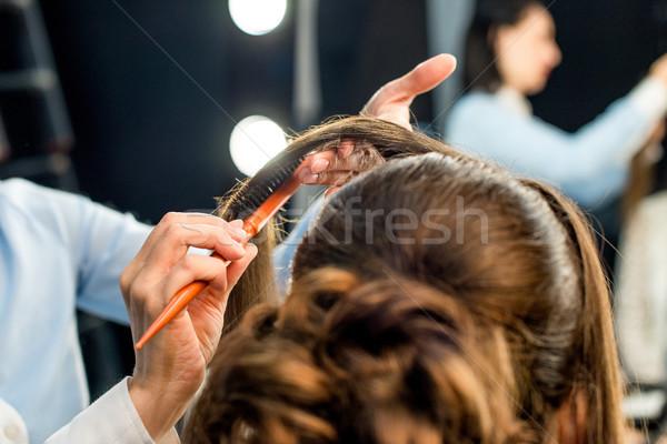hairdresser doing hairstyle Stock photo © LightFieldStudios