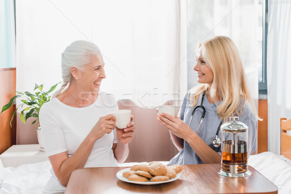 nurse and patient drinking tea  Stock photo © LightFieldStudios