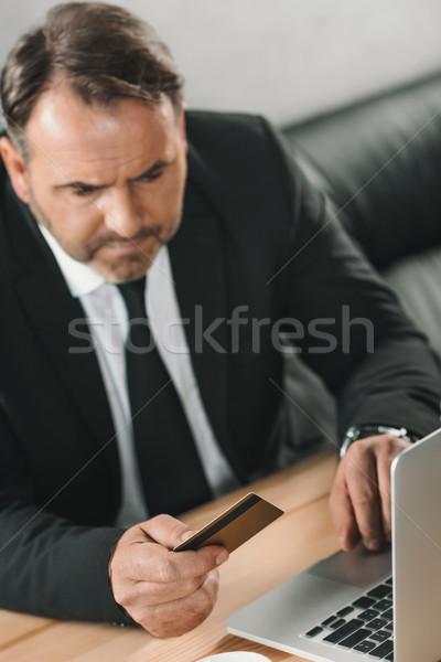 businessman making e-shopping Stock photo © LightFieldStudios