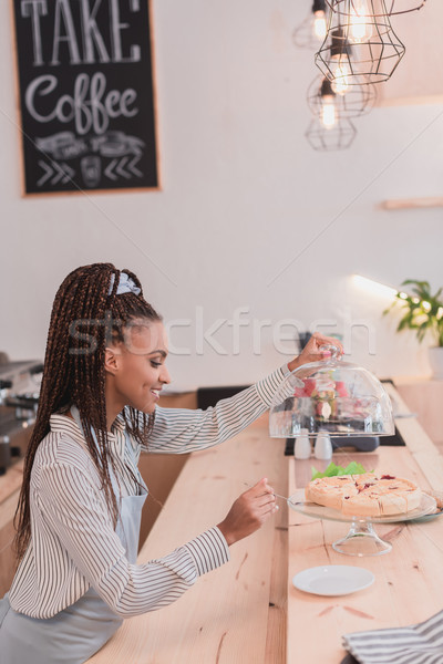 barista taking piece of pie Stock photo © LightFieldStudios