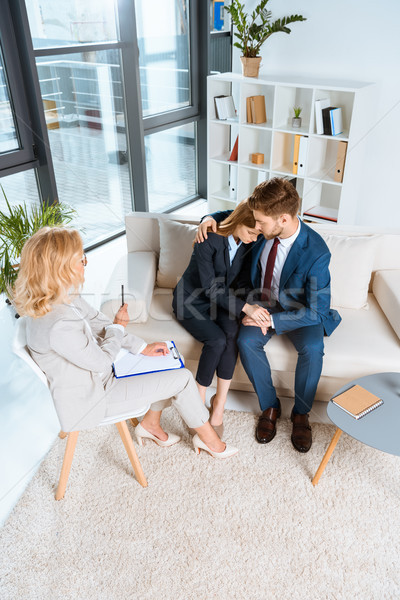Stock photo: young couple and psychologist