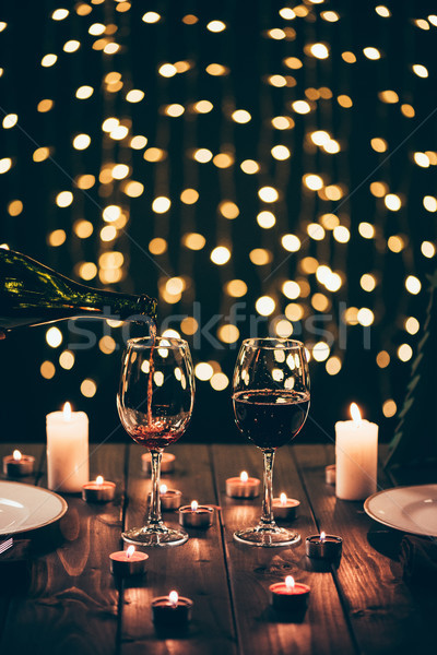 glasses of wine on table with candles Stock photo © LightFieldStudios