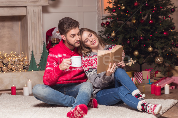 couple reading book at christmastime Stock photo © LightFieldStudios