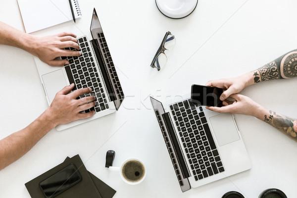 Two men working with laptops Stock photo © LightFieldStudios