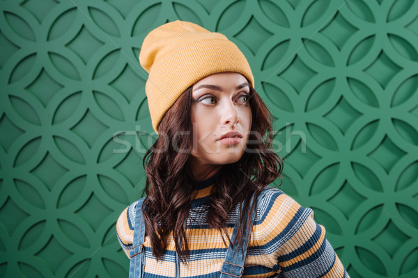 Woman wearing pullover, hat and overalls Stock photo © LightFieldStudios