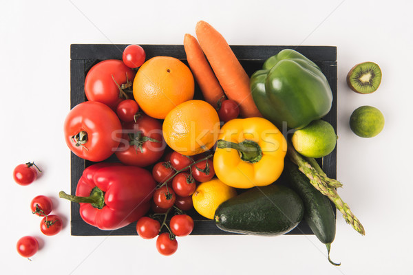 Farmers market concept with vegetables and fruits in dark wooden box isolated on white background Stock photo © LightFieldStudios