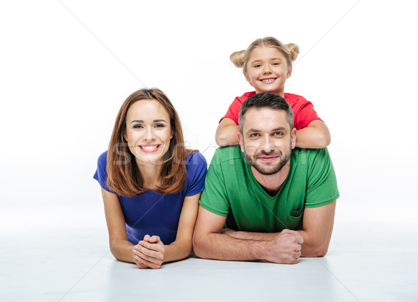 Smiling parents with cute little daughter Stock photo © LightFieldStudios