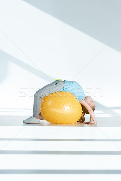 вид сбоку девочку фитнес мяча Сток-фото © LightFieldStudios