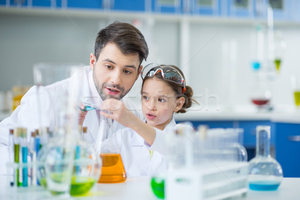 Człowiek nauczyciel dziewczyna student naukowcy Zdjęcia stock © LightFieldStudios