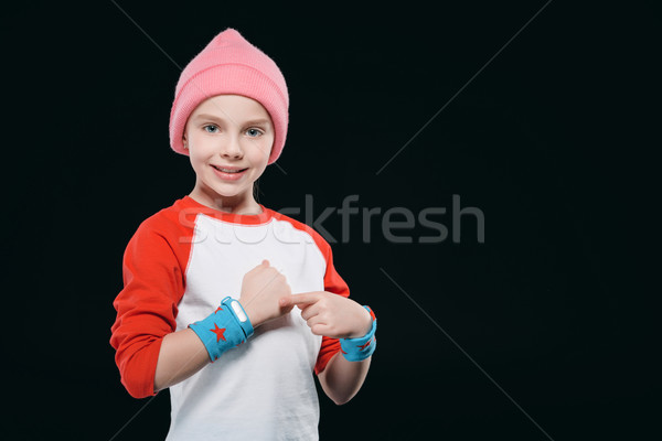 girl in sportswear with sweatband and fitness tracker isolated on black. equipment sport  concept Stock photo © LightFieldStudios